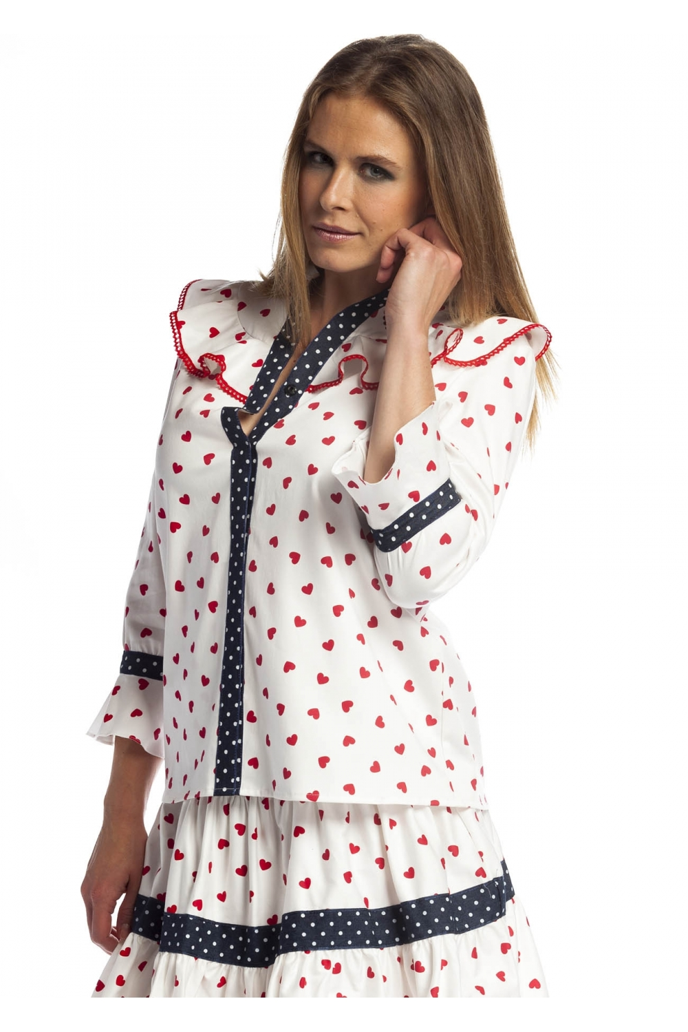 b549d460702 White blouse with a French sleeve. It has ruffles